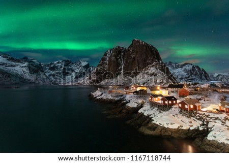 Classic fisherman village in Lofoten island Norway with a beautiful Northern Lights show and mountains #1167118744