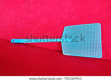 classic fly swatter in vivid colors - Shutterstock ID 781569451