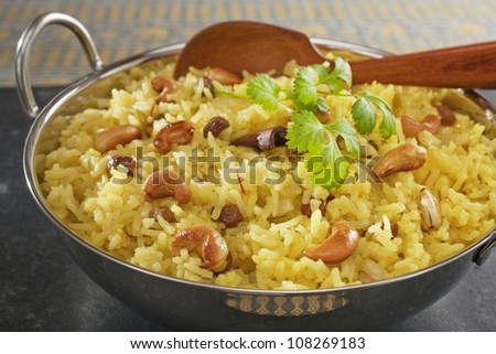 Classic fruit and nut Indian pilau, basmati rice cooked with stock, saffron, garlic, onion, cinnamon, cardamom, sultanas and garnished with cashew nuts and coriander.