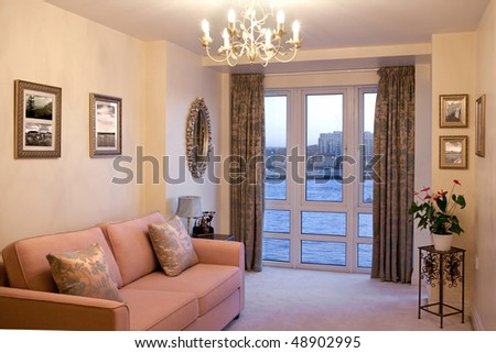 Classic furniture in room overlooking river