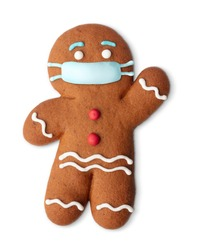 Classic gingerbread cookie man with medical mask isolated on white