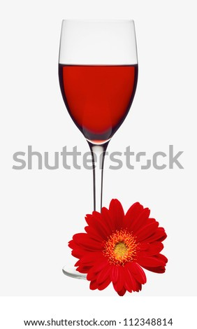 Classic Glass of Red Wine and Red Gerbera Flower isolated on white background