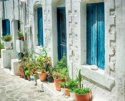 Classic Greek House Facade with blue door and windows - Milos Island - Greece