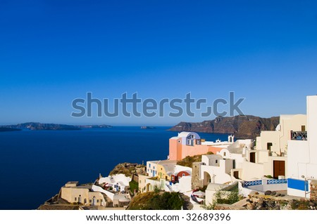 classic greek island architecture with view of aegean mediterranean sea and the caldera volcanic island of oia santorini greece cyclades islands