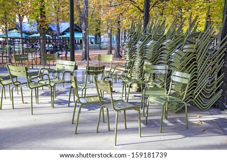 Classic green iron outdoor chairs of the Luxembourg garden piled in one of the garden\'s pavilions, Paris, France
