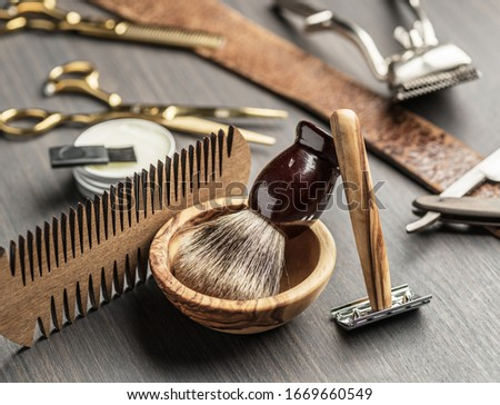 Classic grooming and hairdressing tools on wooden background. Top view on barbershop instruments  laying on dark wooden table. Photo stock ©