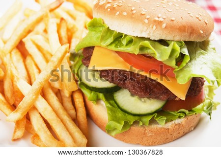 Classic hamburger with french fried, cheese, tomato and lettuce
