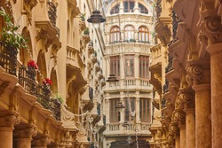 Classic historical antique buildings facades passageway in Albacete. Spain