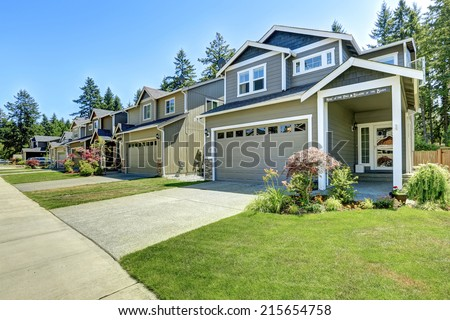 Classic house exterior. Entrance porch with driveway and front yard landscape
