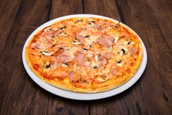 classic Italian pizza on a wooden table