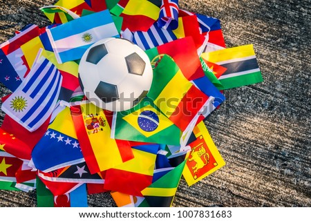 Classic leather soccer ball with nations teams flags of the participating countries in the tournament. #1007831683