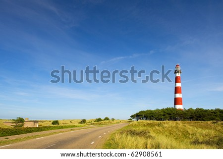 classic lighthouse in red and white at Dutch island Ameland - stock photo