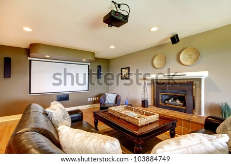 Classic Living room with projector screen and fireplace.