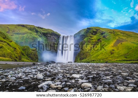 Classic long exposure view of famous Skogafoss waterfall in beautiful twilight during blue hour at dusk in summer, Skogar, south of Iceland #526987720
