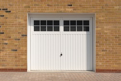 Classic look, white side hinged garage doors, on a newly built house. Hertfordshire. UK