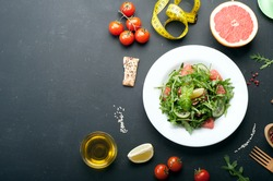 Classic low-calorie diet with salad, boiled eggs and grapefruit. Useful vegetarian food. Place for writing text or recipe.