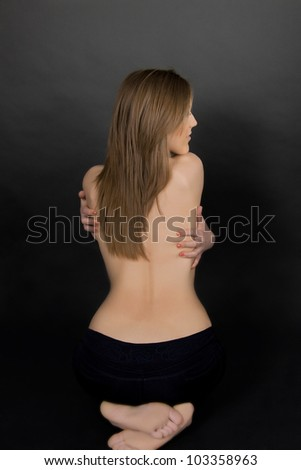 Classic low-key photo of sexy woman on back