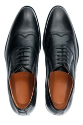 Classic male black leather shoes isolated on a white, top view