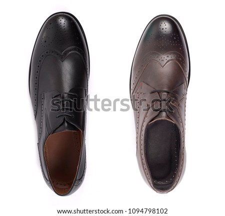 Classic male shoes isolated on a white, top view #1094798102