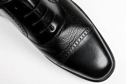 Classic men's black shoe - macro on white background