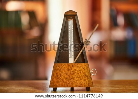 Classic metronome in a room with warm tone