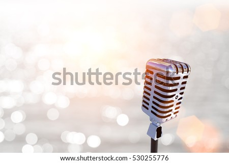 classic microphone on abstract blur Bokeh light for party 2017 background and Clipping path