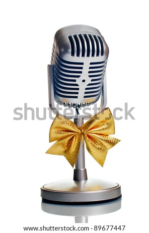 Classic microphone with golden bow tie isolated over white
