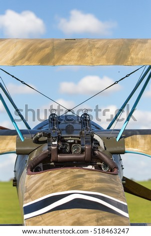 Classic military plane with guns view from cockpit