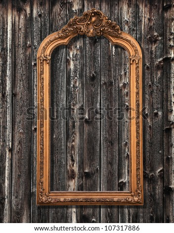 Classic mirror frame on a wooden wall