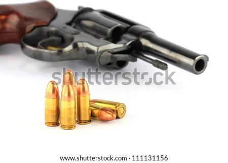 Classic .38mm revolver handgun with bullets on white background