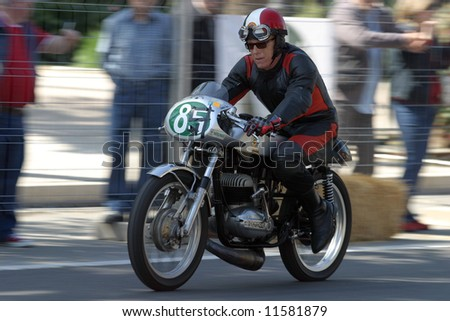 Classic motorcycle during an exhibition at the central park of Malaga city, Spain.