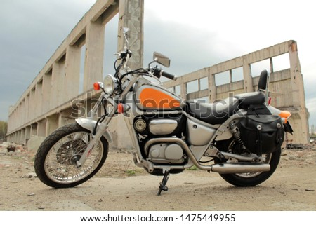 classic motorcycle on the background of a ruined building. #1475449955
