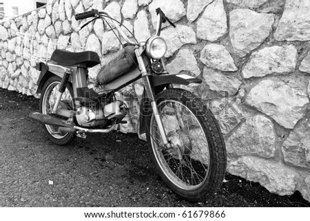 classic old motorcycle on the stones wall