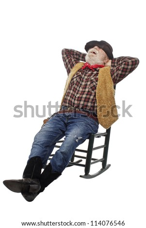 Classic Old West style laughing cowboy with felt hat, grey whiskers, revolver. He relaxes leaning back in a rocking chair. Isolated on white, vertical, copy space.