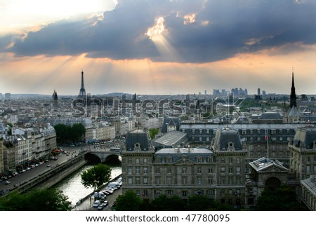 Classic panorama of Paris in France. View of sunset from Notre Dame de Paris. Eiffel tower in the left side. Historic buildings in a front on island de la Cite.