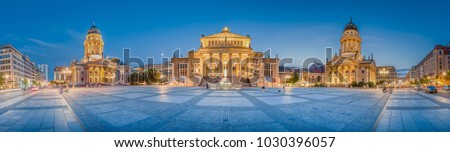 Classic panoramic view of famous Gendarmenmarkt square with historic Berlin Concert Hall and German and French Churches in twilight at dusk, Berlin, Germany
