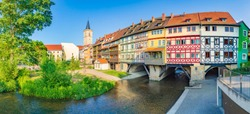 Classic panoramic view of the historic city center of Erfurt with famous Krämerbrücke bridge illuminated at at sunset. Thüringen, Germany