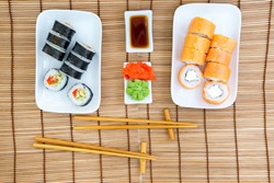 classic Philadelphia sushi and vegetarian rolls with vegetables rolls with salmon and cheese. Japanese cuisine dish top view
