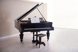 Classic piano in empty room