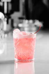 classic Pink Lady cocktail closeup on bar counter with copy space