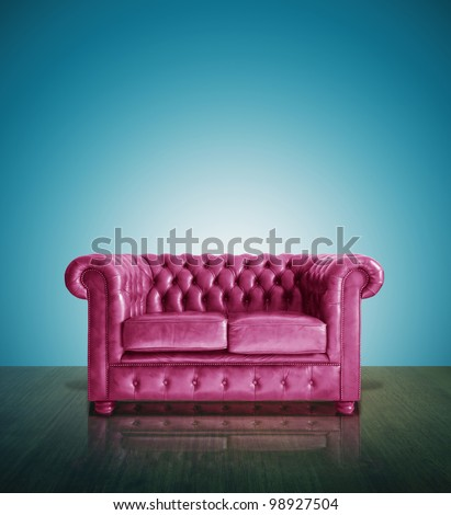 Classic pink leather sofa and  blue background.