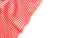 Classic pink plaid fabric or tablecloth on white background with copy space.