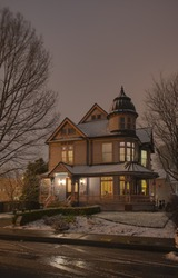 Classic Queen Anne Victorian house with wrap-around front porch, turret and exotic onion dome copper roof built in 1888 located in Old Northside Neighborhood historic district Indianapolis Indiana.