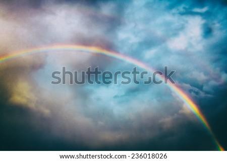 Classic Rainbow. A rainbow across the sky, edited with vintage film effects.