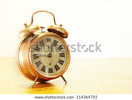 Classic retro old rusty clock with moving pointers