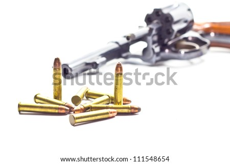 classic revolver and bullets isolated on white background - stock photo