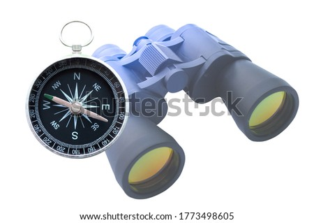 Classic round travel compass and classic travel binoculars isolated on white background as symbol of tourism with compass, travel with compass and outdoor activities with compass