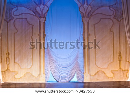 classic scenography with curtains and blue lights in old theater