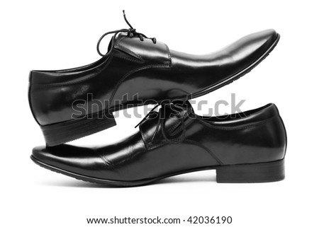 Classic shiny black men's shoes standing on each other