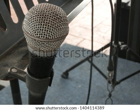 classic single microphone in the blur background indoor. open mic for public speech and entertainment.